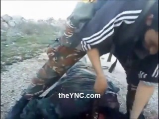 New Beheading Shows Rebel Taking off a Syrian Soldiers Head with a Army Knife